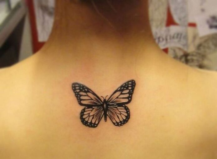 Grey-And-Black-Butterfly-Tattoo-On-Girl-Upper-Back