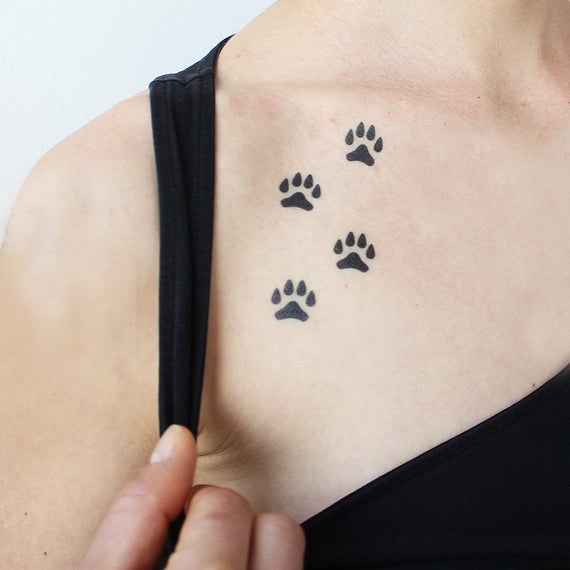Paws All over again tattoo for girls on neck